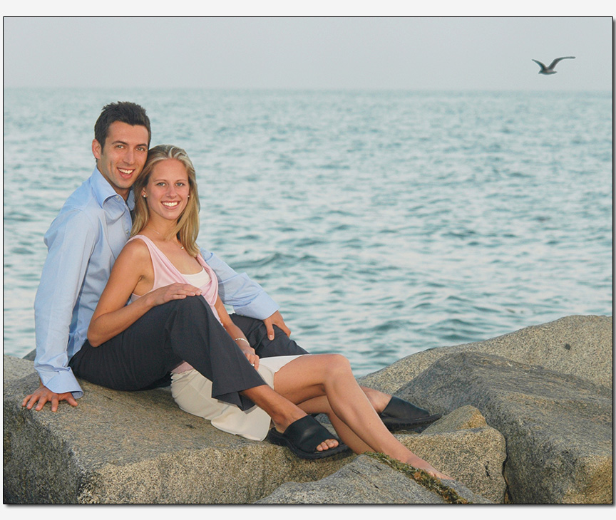 relaxed couple casual pose rocky beach
