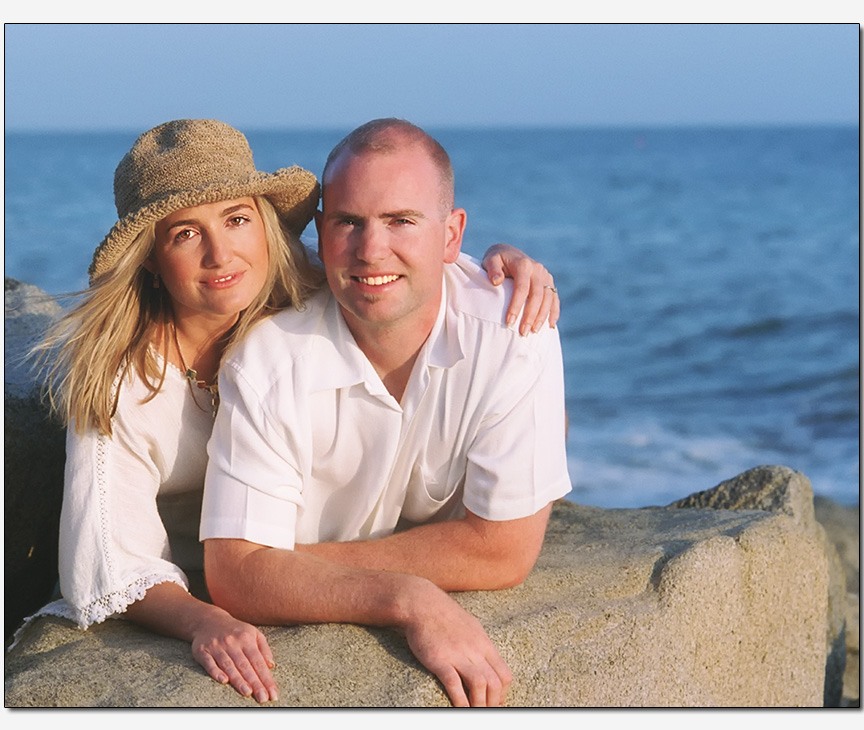 engagement session feature couple on a beach