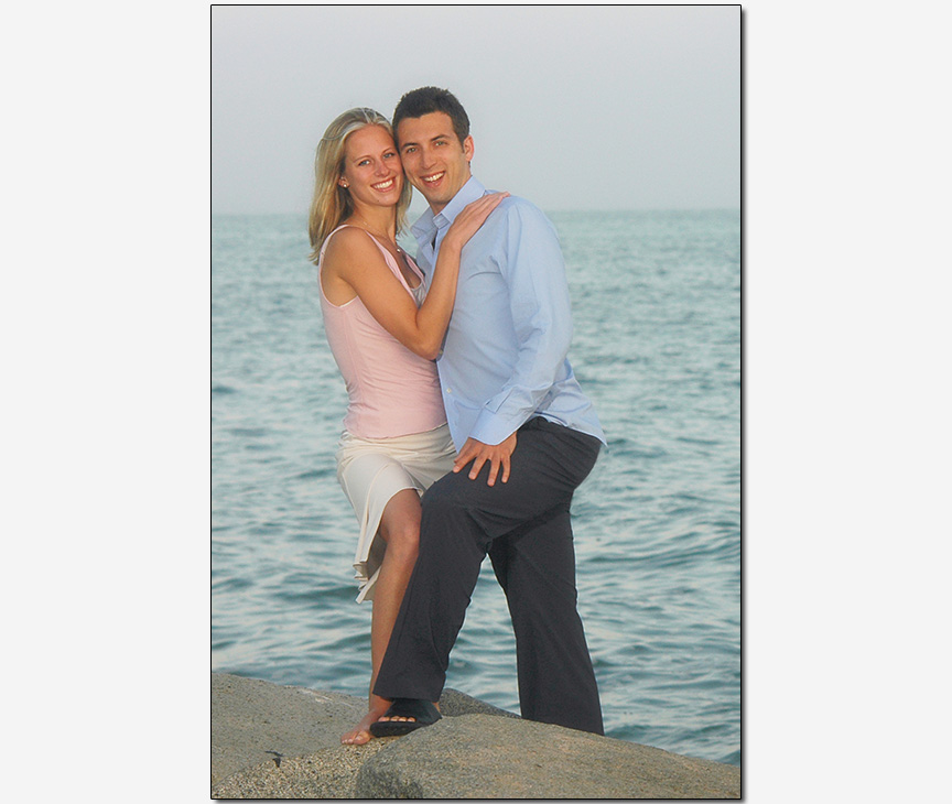 engagement session of an interfaith couple on rocky beach