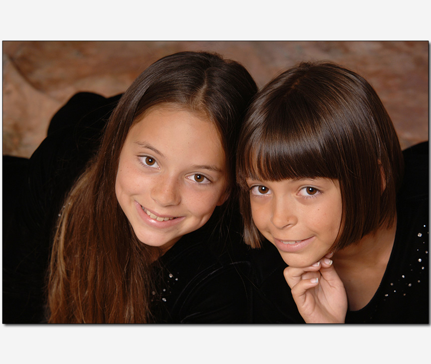 two young sisters in a cute pose