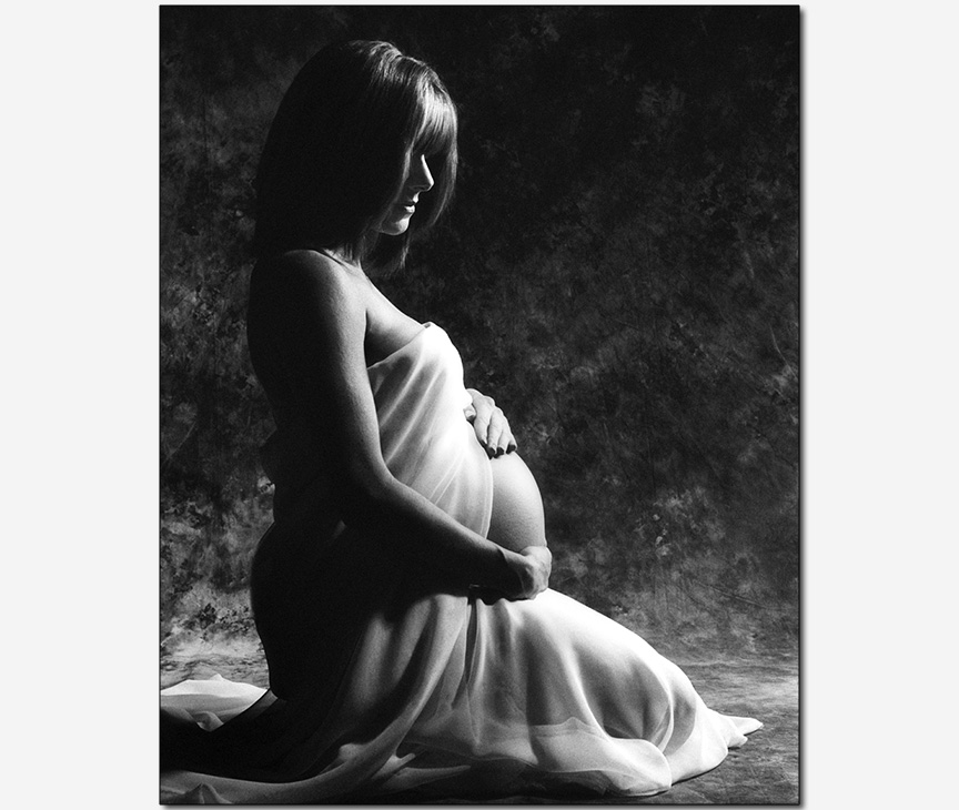 woman gently caressing her daughter in her womb